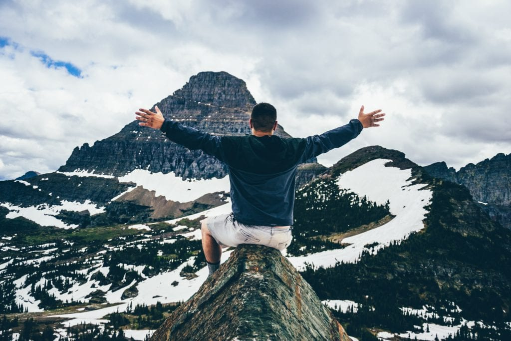 Scene of Mountain visible to man open arms to God's plan
